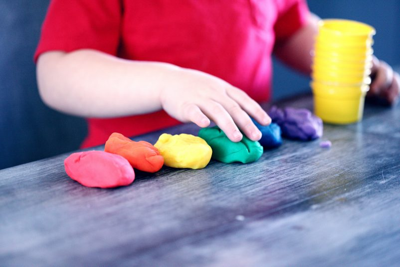 child playing with play dough